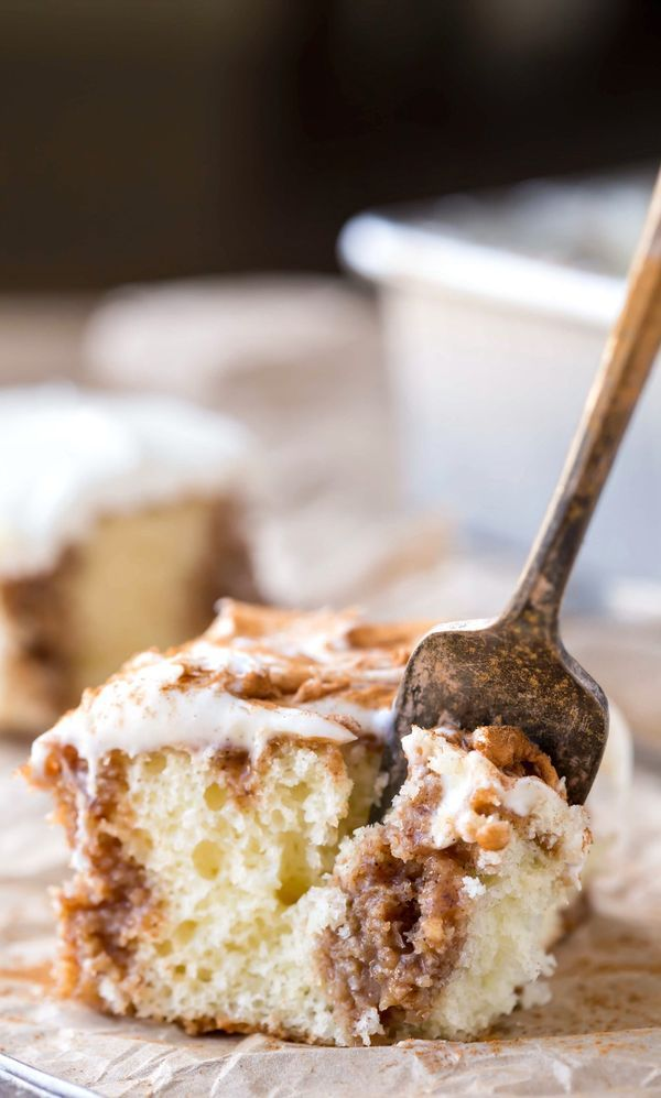 Cinnamon Roll Poke Cake Recipe - everyone loves this easy dessert! Great to take to a barbecue, picnic, or a pot luck!