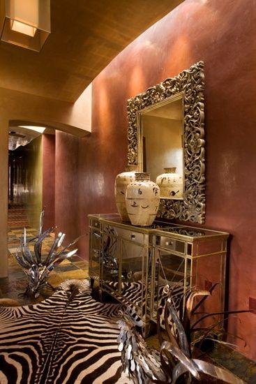 Rich color, zebra rug, mirror, lighting...very rich. Designer: David Naylor...
