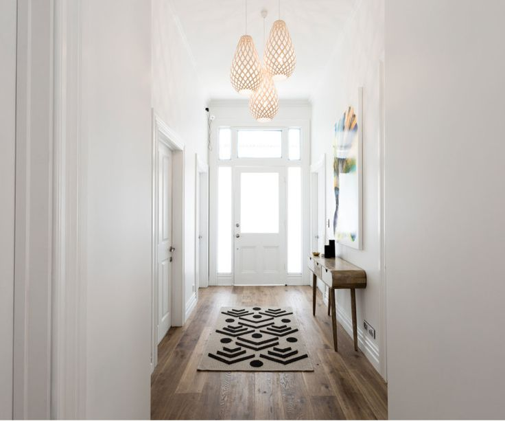 ENTRY WAY - Off centre to the right as you walk in to fill the window space - 3 pendant lights?  Carrying their light and earthy theme throughout the house, these Kōura pendant lights look stunning against the crisp white walls and dark timber flooring