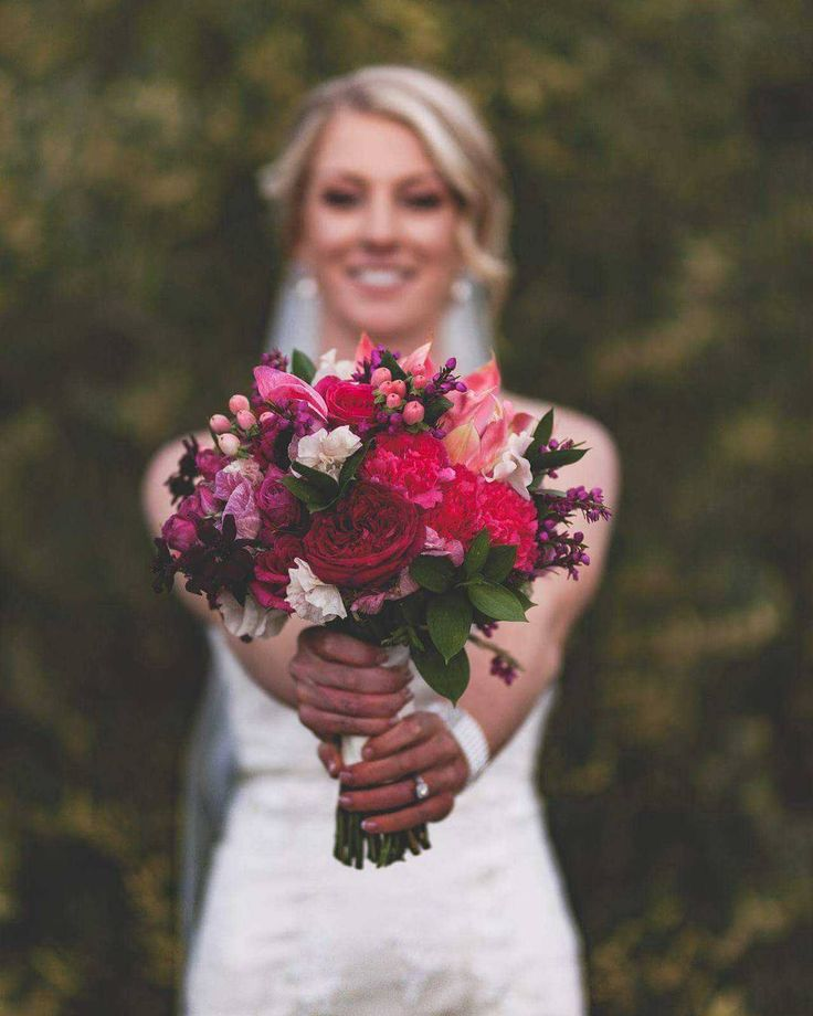 Beautiful modern bridal wedding flowers. Bouquet with pinks and greens.
