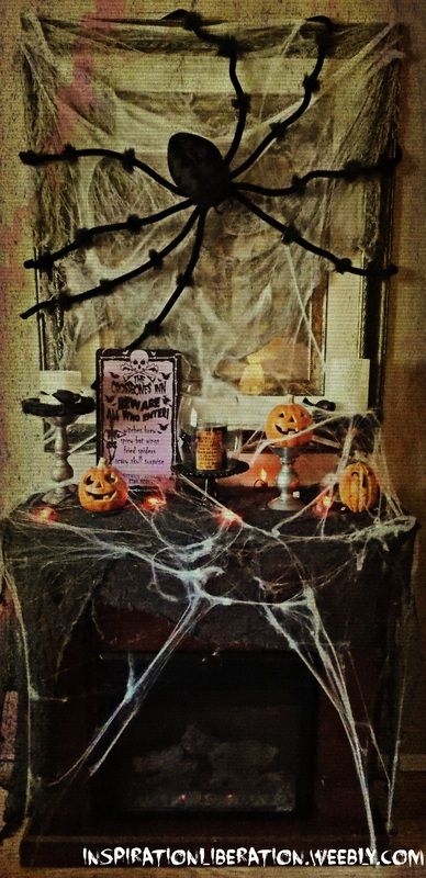 step by step instructions on how to create a layered and spooky halloween fireplace mantle