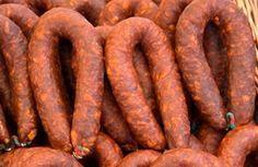 Chorizo Sausage: 5 lb ground pork; 1 c cold white wine; 8 t paprika; 1/2 c crushed chili peppers; 2 t cinnamon; 1 T cumin; 3 md onions, finely chopped; 2 t dried oregano; 1 T  garlic powder; 2 T salt; Optional for hot chorizo - 4 t cayenne