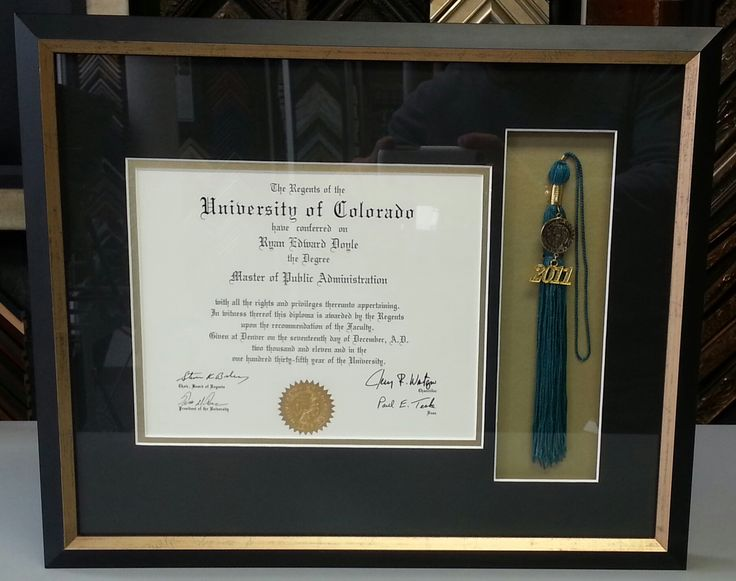 Custom framed University of Colorado diploma and tassel in a shadowbox frame. Custom framed by FastFrame of LoDo.