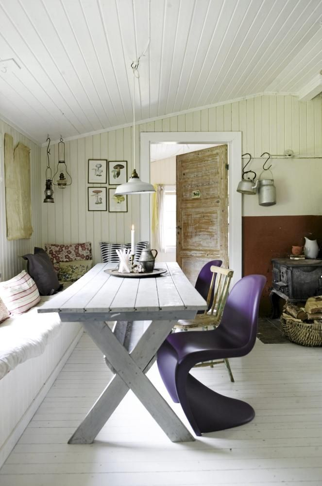 A rustic dining spot gets a modern update with curvy eggplant-coloured chairs.