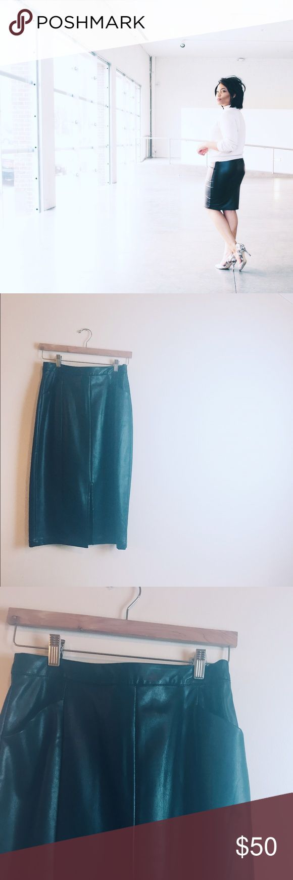 🎉FRI-YAY SALE | Leather Black Skirt Heavily lined and deep pockets! Worn once (for the first photo). Cute slit in the middle on front of Skirt. Zips and clasps in the back! | very open to reasonable offers Skirts Pencil