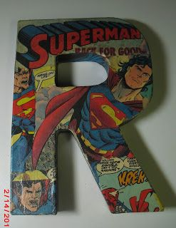 Mod Podged Comic Book Letters for Boy Room. I was just thinking how I would love to put the first letter of their names on the bedroom door and I then come across this. Hmm I say it's fate. I am doing it!