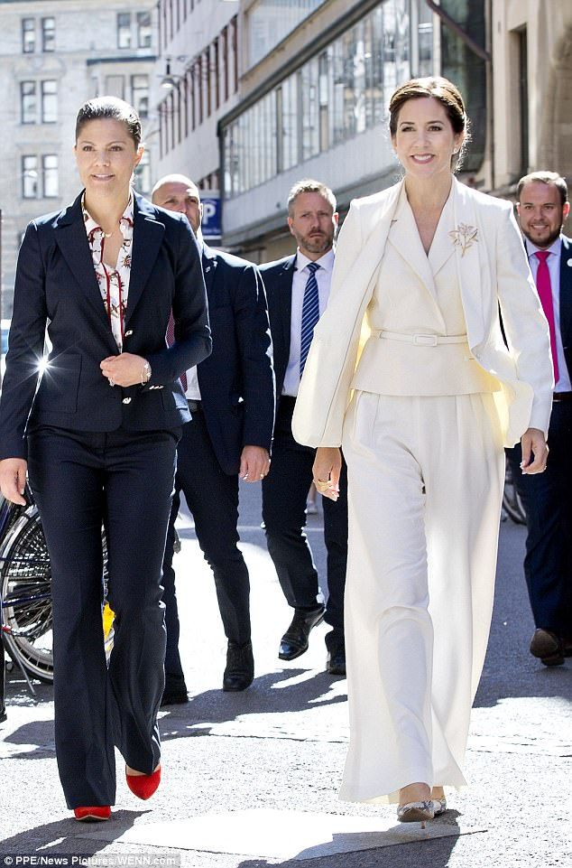 Crown Princess Victoria of Sweden and Crown Princess Mary of Denmark were twinning in sharp tailoring today as they visited theDanish jewellery boutique Olen Lynggaard, in Stockholm