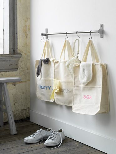 Make a Laundry Center  A curtain rod and tote bags becomes a laundry sorting center. - make have to have 2 hooks per bag...
