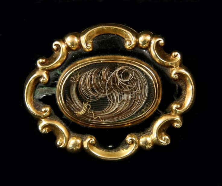 Queen Victoria's mourning brooch containing Albert's hair (1867)