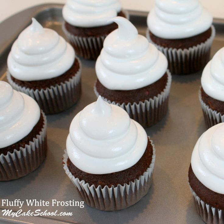 Top your cakes and cupcakes with this light and airy Fluffy White Frosting recipe!  Perfect for Hi Hat Cupcakes! MyCakeSchool.com.