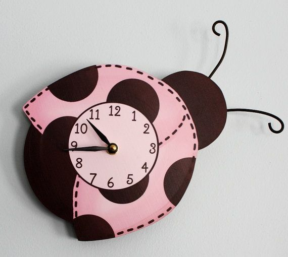 Hey, I found this really awesome Etsy listing at http://www.etsy.com/listing/94966844/mod-ladybug-wooden-wall-clock-for-girls