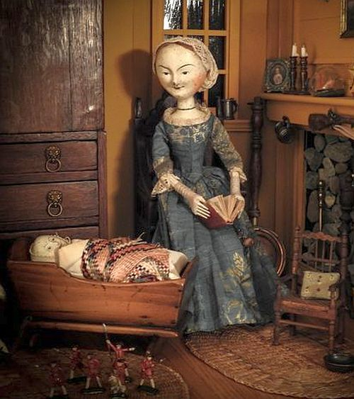 Old Wooden Peg Doll with her Baby in a wooden Cradle.