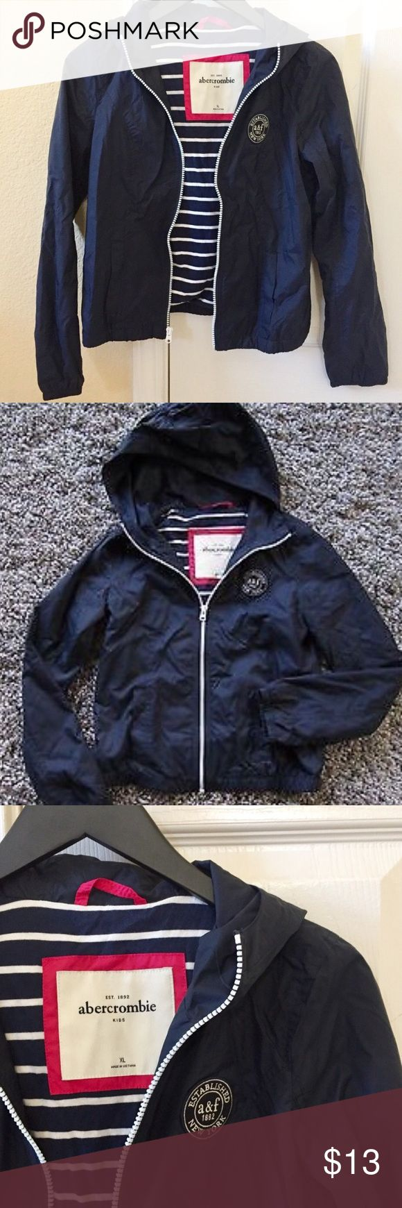 Abercrombie Girl's Rain Jacket - XL NWOT! Navy rain jacket with cotton interior lining from Abercrombie. Size XL; fits adult PXS / 00P, but this particular garment rubs short. Perfect condition. Selling because too small on me abercrombie kids Jackets & Coats