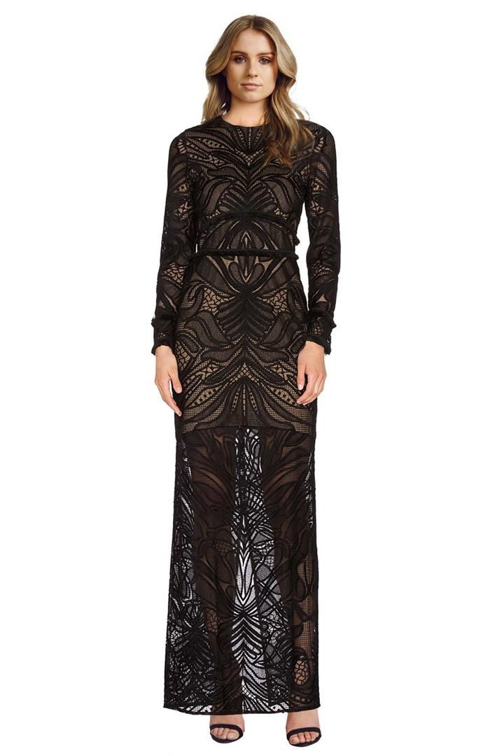 This incredible floor-length gown by Alexis is constructed out of placement lace that is symmetrical over the body. It is partially lined; allowing the lace to contrast against the skin beautifully. It also features fringe trim at the waist panels and cuffs of the long sleeves. This dress is absolutely stunning and will definitely turn heads at your next evening event! Placement lace that is symmetrical over the body Partially lined Fringe trim at the waist panels and cuffs of the long…