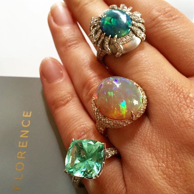 Kat Florence's rings -(left)green Tourmaline, (middle)crystal Opal and (top right) a blue-green black Opal