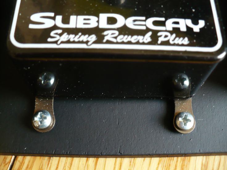 Closeup view of the Reverb pedal attached to the board.
