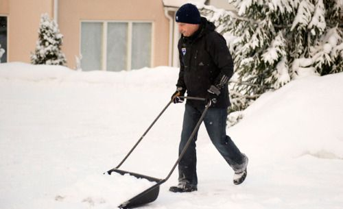 12th President of Finland Sauli Niinistö shoveling snow the day after elections