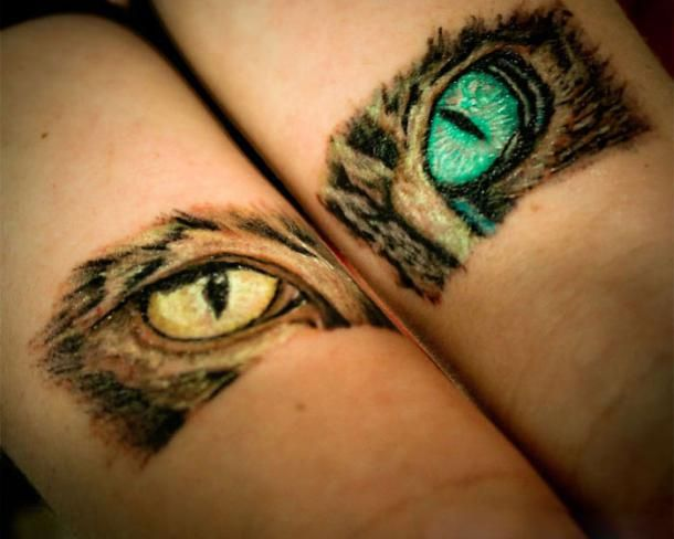 Awesome cat eyes tattoo idea. The green and the yellow eyes. Color: Colorful. Tags: Cool, Creative, Matching, Awesome