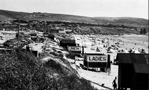 The changing sheds at Brighton Beach in South Australia in 1930. •State Library of South Australia•