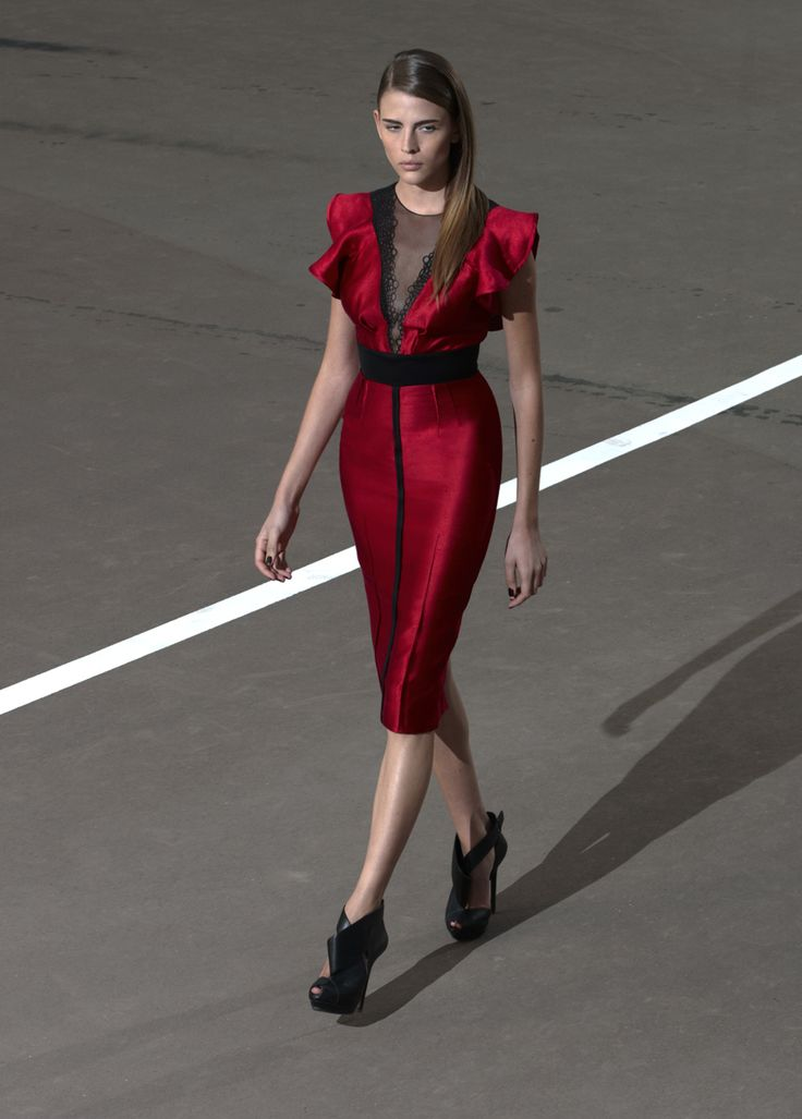 Below knee length red dress with black detailing