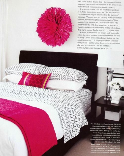 love the black and white sheets with a pop of color.