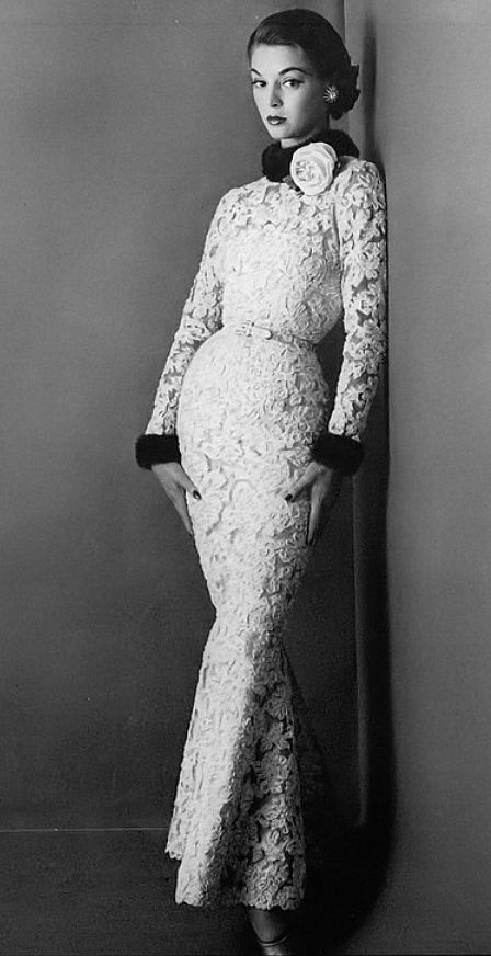 1952 Jean Patchett in sheath of nude imported Ribbonzine lace trimmed in mink at the collar and cuffs by Traina-Norell