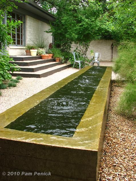 And in another courtyard formed by two wings of the house, a trough-style, negative-edge water feature adds contemporary style.