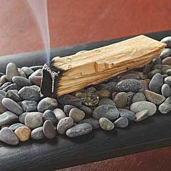 A mystical tree grows in South America known as Palo Santo, or Holy Wood. Related to Frankincense, Myrrh, and Copal, this aromatic wood has been used for thousands of years by shamans and the Incas, often burned for space clearing and in ceremonies. Believed to be energetically cleansing, its smoke may remind you of citrus, mint, and/or neroli.  | www.ancient-wisdoms.com