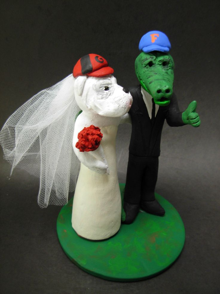 Custom made to order Florida Gator  and Georgia Bulldog college mascot wedding cake toppers. $235 www.magicmud.com 1 800 231 9814 magicmud@magicmud... blog.magicmud.com twitter.com/... $235 #mascot #collegemascot #hokie #ms.wuf #gators #virginiatech #football mascot #wedding #toppers #custom #Groom #bride #weddingcaketoppers #caketoppers www.facebook.com/... www.tumblr.com/... instagram.com/... magicmud.com/Wedding photos.htm