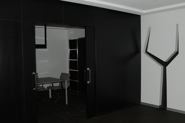 Associazione Artigiani_Trento. Director office: ebony sliding door, crystal tree inserted in wall.
