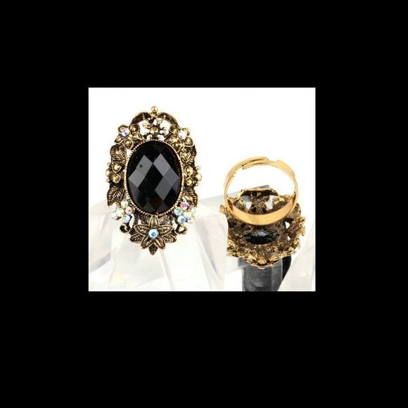 BUY 2 GET 3 FREE! Gold & Black. Gold ring with black centerpiece & floral design. Adjustable band for the perfect fit. NWT Jewelry