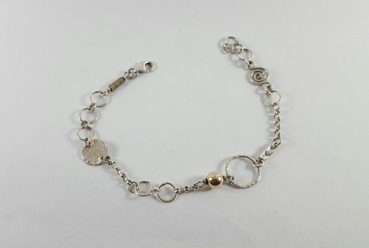 Silver and gold bracelet, R500.00