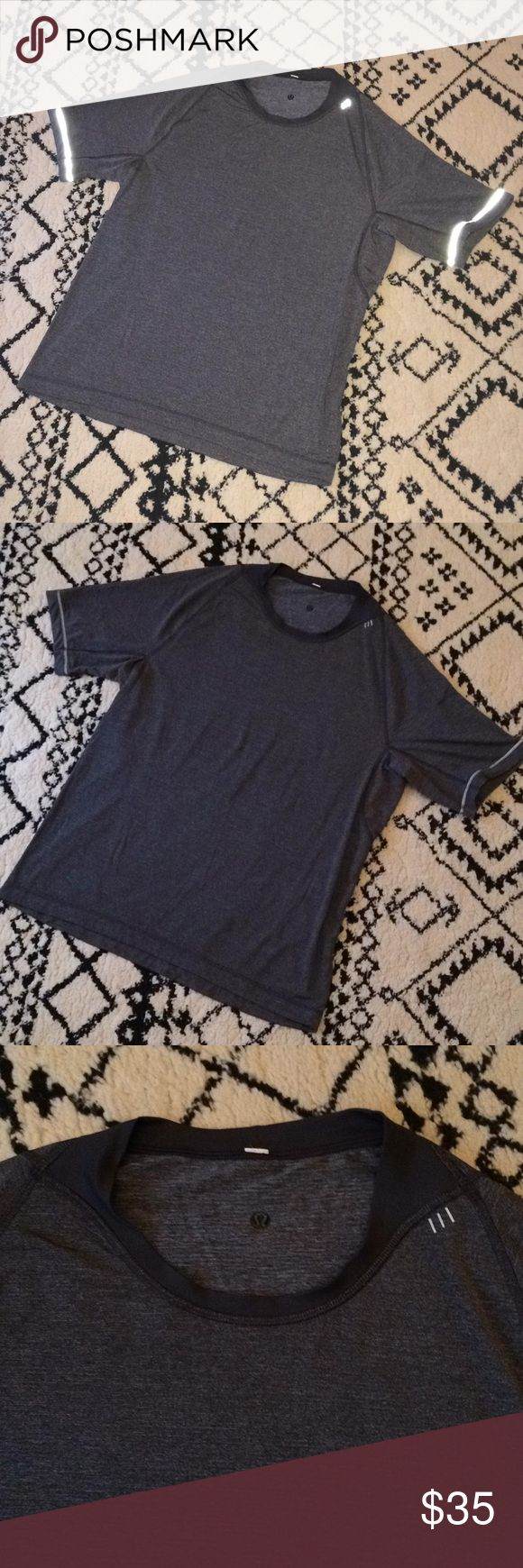 Lululemon l Grey Short Sleeve Crewneck Lightweight Lululemon Athletica medium-dark tone gray crewneck short sleeve top. A little bit heather gray, tinge of white mixed in. Reflective stitching on the sleeves and a little bit at the front. Tag has been cut out, Measures like an extra large. Excellent pre-loved condition. lululemon athletica Shirts Tees - Short Sleeve
