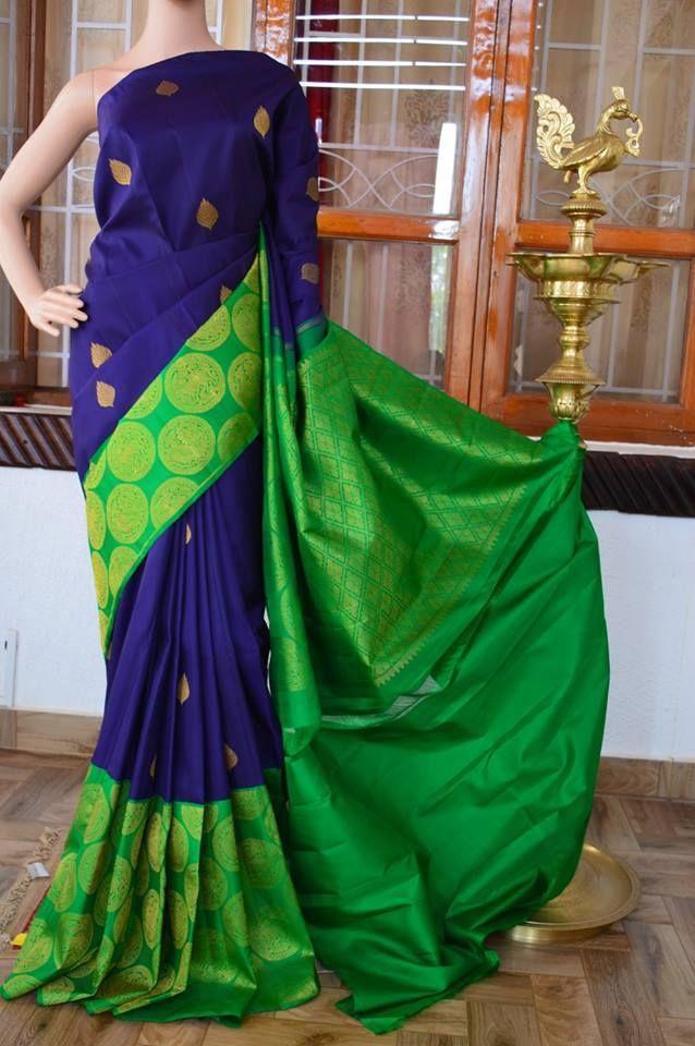 Navy blue pure silk pure zari kanchivaram silk saree with zari butta on full body and parrot green zari circle butta big border and zari rich pallu. Code: A0817KA020116 Cost: 22000 INR