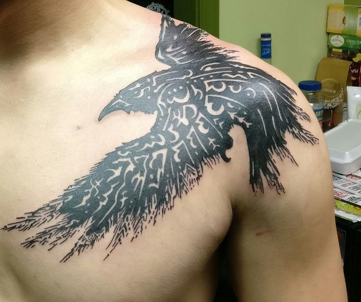 Raven tattoo on shoulder