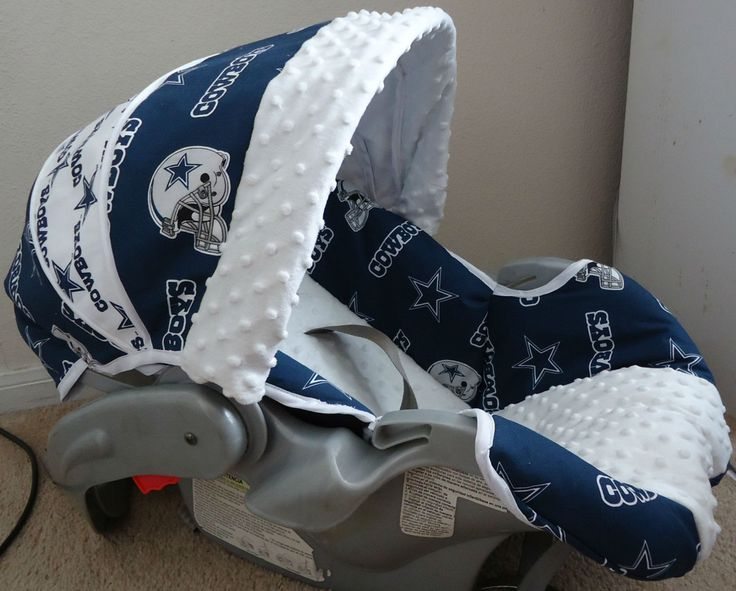 dallas cowboys baby carseat cover..might be going overboard...but Ryan would luv it!!hahah
