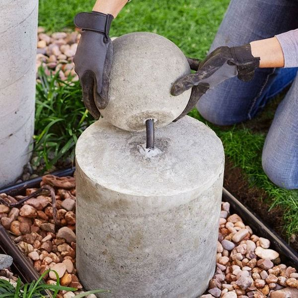 Make this diy concrete sphere fountain diy concrete for Diy water wall fountain outdoor