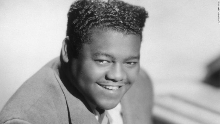 """Antoine """"Fats"""" Domino, a titan of early rock 'n' roll whose piano-based hits -- such as """"Ain't That a Shame,"""" """"Blueberry Hill"""" and """"Blue Monday"""" -- died from natural causes."""