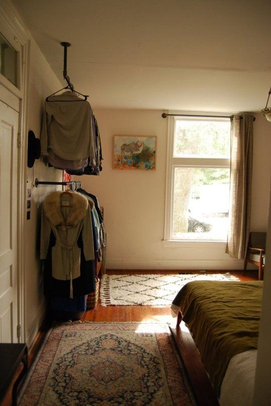 Love this idea for hanging clothes in a room without using a closet! Flooring Fix: 4 of the Biggest Rug Mistakes to Avoid