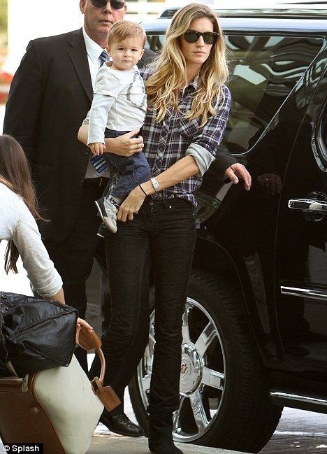 Baby love: Gisele Bundchen carries her son Benjamin Brady as she arrives at LAX airport yesterday to take a flight to Brazil