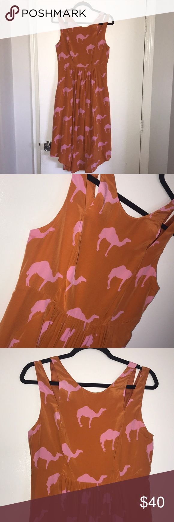 Summery flowy shift dress Super flowy, bright shift dress! Features a super fun pink camel print,  double split shoulder straps and an exposed zipper! Hem of dress is rounded for a casual or dressed up vibe! Would also be a super cute garden party dress! Worn once to my engagement party! Anthropologie Dresses Midi