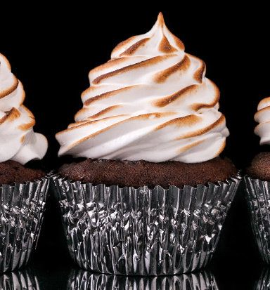 Recipe For Chocolate Cupcakes with Toasted Marshmallow Frosting Recipe - These dark, chocolaty cupcakes crowned with fluffy toasted-marshmallow frosting are as tasty as they are beautiful.