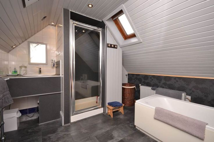 Bathrooms can often be awkward shapes. The best trick is going with the flow of the room, make use of small spaces to build into like this sink, walk in shower and hanging storage.