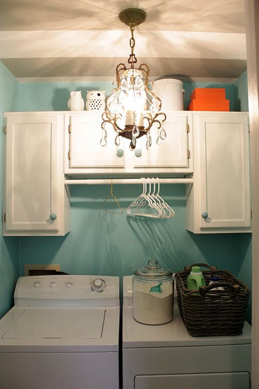 install unfinished cabinets above my washer & dryer and paint them a fun color! I'm doing this!