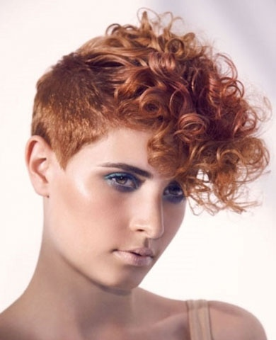 I'd probably not go as far up on the scalp as with the buzz, but other than that, love this curly mohawk.