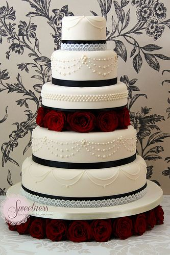 Black, red and white Wedding Cake with piping detail