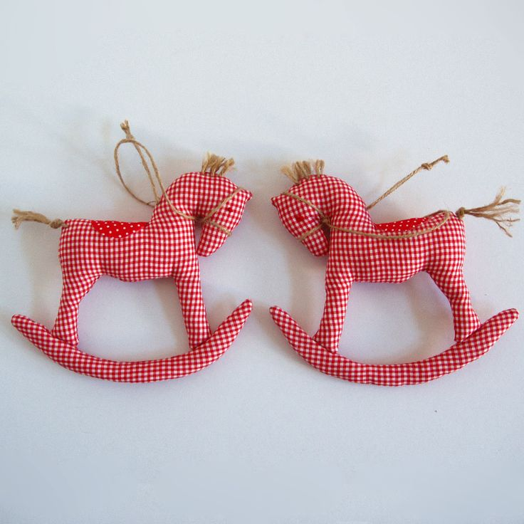 Fabric, hanging, delicate rocking pony in red plaid, with saddle and reins.