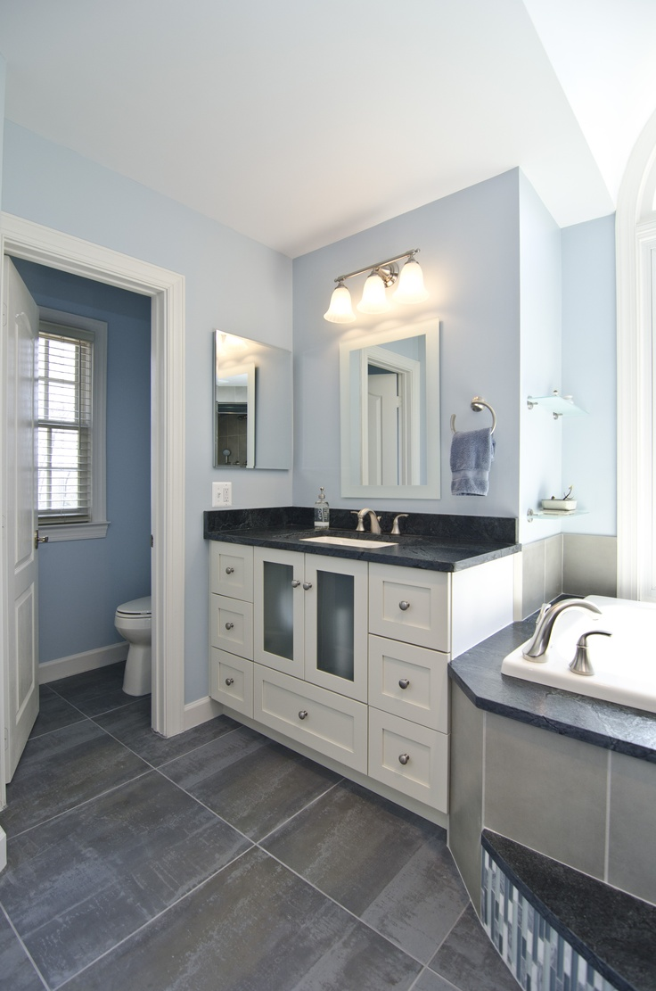 grey leather soapstone tops the vanity the faucet and bath accessories are by kohler