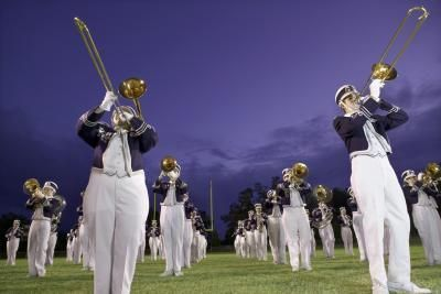 Marching band members are not just musicians, they're endurance athletes as well. According to Chris Mader of Dynamic Marching, band members are likely to march five to 10 miles daily at band camp in the sun, while carrying heavy instruments. Preparing for this level of physical activity requires strength training, cardiovascular training and...