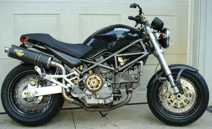 older generation monster with carbon wire-spoke wheels. | ducati
